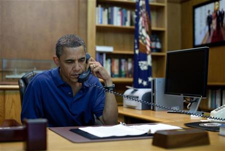 U.S. President Barack Obama holds a conference call from Camp David, Maryland, in this August 6, 2011 photo release. REUTERS/Pete Souza/The White House/Handout