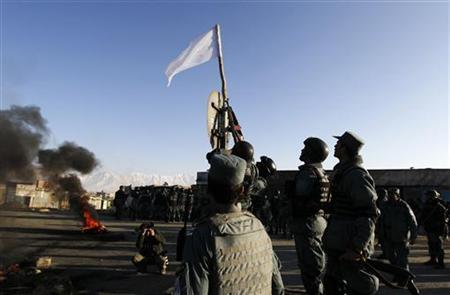 Afghan policemen confiscate a Taliban flag during a  protest in Kabul February 24, 2012.REUTERS/Omar Sobhani