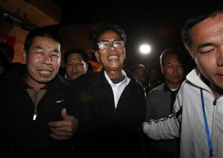 Lin Zuluan (C) is accompanied by other villagers after being elected as village chief in Wukan, southern Chinese province of Guangdong March 3, 2012. REUTERS/Bobby Yip