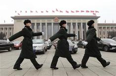 """Soldiers of the Chinese People's Liberation Army (PLA) march in front of the Great Hall of the People, the venue of the National People's Congress or parliament, in Beijing March 2, 2012. China is likely to unveil its military spending for 2012 on the weekend, flagging the direction that Beijing will take after President Barack Obama launched a new """"pivot"""" to reinforce U.S. influence across Asia. REUTERS/Jason Lee"""