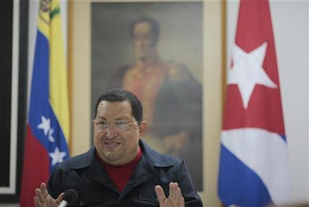 Venezuela's President Hugo Chavez talks during a meeting with his cabinet while recovering from a surgery in Havana, March 3, 2012. REUTERS/Miraflores Palace/Handout