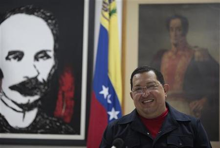 Venezuela's President Hugo Chavez talks during a meeting with his cabinet while recovering from a surgery in Havana March 3, 2012. REUTERS/Miraflores Palace/Handout