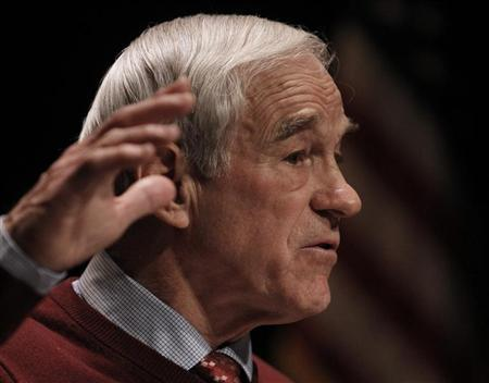 Republican presidential candidate Ron Paul gestures as he speaks at a rally in Golden Valley, Minnesota, February 7, 2012. REUTERS/Eric Miller