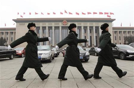 Soldiers of the Chinese People's Liberation Army (PLA) march in front of the Great Hall of the People, the venue of the National People's Congress or parliament, in Beijing March 2, 2012. China is likely to unveil its military spending for 2012 on the weekend, flagging the direction that Beijing will take after President Barack Obama launched a new ''pivot'' to reinforce U.S. influence across Asia. REUTERS/Jason Lee