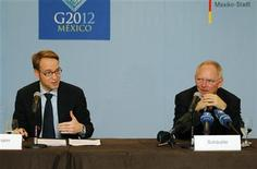 Deutsche Bundesbank President Jens Weidmann (L) and German Finance Minister Wolfgang Schaeuble attend a meeting with media as part of Group of Twenty (G20) leading economies' finance ministers and central bankers in Mexico City February 25, 2012. REUTERS/Tomas Bravo