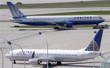 A United Airlines plane with the Continental Airlines logo on its tail, taxis to the runway while another United plane heads for the gate at O'Hare International airport in Chicago October 1, 2010. REUTERS/Frank Polich