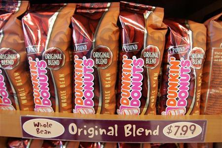 One pound bags of Dunkin' Donuts Original Blend coffee are on display at a Dunkin' Donuts store in Tewksbury, Massachusetts December 20, 2005.  REUTERS/Jessica Rinaldi