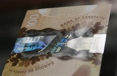 A hologram security feature is seen on the new Canadian 100 dollar bill made of polymer in Toronto November 14, 2011. REUTERS/Mark Blinch