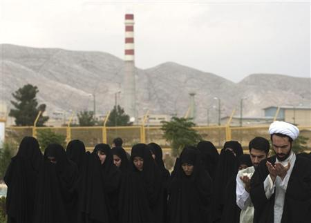 An Iranian cleric prays as a prayer leader for female students before a ceremony to form a human chain around the Uranium Conversion Facility (UCF) to show their support for Iran's nuclear programme in Isfahan, 450 km (280 miles) south of Tehran November 15, 2011. REUTERS/Morteza Nikoubazl