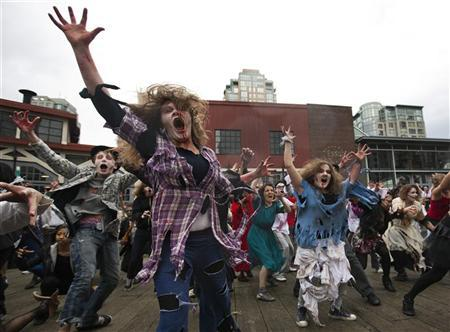 People dressed as Zombies dance to Michael Jackson's ''Thriller'' in downtown Vancouver, British Columbia October 23, 2010. REUTERS/Andy Clark