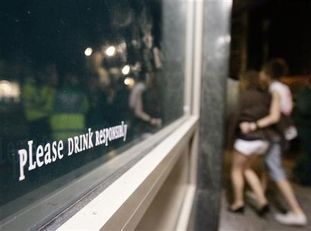 A message is seen on a bar window in Lincoln, eastern England, in this April 27, 2009 file photo.    REUTERS/Darren Staples/Files