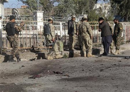 Afghan policemen investigate at the site of a suicide bomb attack in Nangarhar province, March 5, 2012. REUTERS/Parwiz