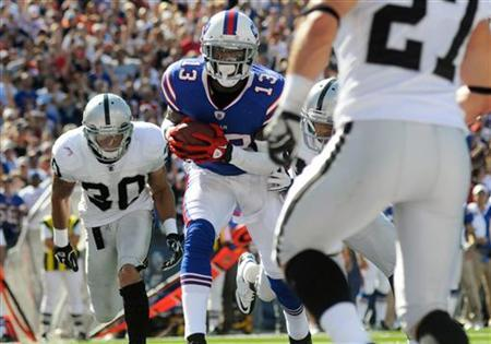 Buffalo Bills wide receiver Stevie Johnson (13) is in for a touchdown against the Oakland Raiders in the third quarter of their NFL football game in Orchard Park, New York September 18, 2011.       REUTERS/Doug Benz