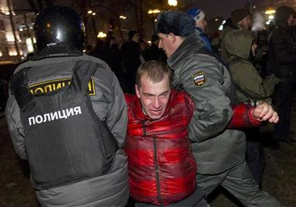 Russian police detain a participant during an opposition protest demanding fair elections in central Moscow March 5, 2012. Thousands of protesters chanting ''Russia without Putin'' took to the streets of Moscow and St Petersburg on Monday to challenge Vladimir Putin's victory in a presidential election which international monitors said was unfair.     REUTERS/Thomas Peter