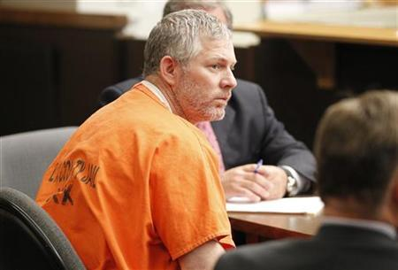 Former Major League baseball player Lenny Dykstra appears in Los Angeles Superior Court for an arraignment in San Fernando, California August 8, 2011. REUTERS/Danny Moloshok/Files