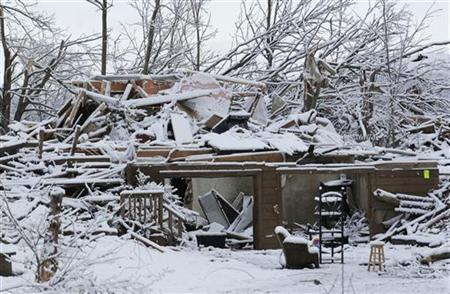 Snow covers a storm-damaged home in Henryville, Indiana, March 5, 2012. REUTERS/John Sommers II