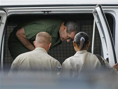 R. Allen Stanford exits a van upon arriving at federal court for a hearing before U.S. District Judge Nancy Atlas in Houston August 24, 2010.   REUTERS/Richard Carson