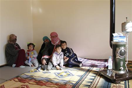 Syrian refugees, who fled the violence in the Syrian town of Qusair, sit at a temporary home, in the hillside town of Arsal in Lebanon's Bekaa Valley, March 5, 2012. REUTERS/ Mohamed Azakir