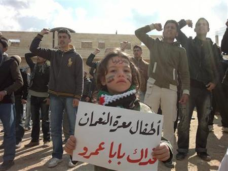 Demonstrators protest against Syria's President Bashar Al-Assad in Marat al-Numan near the northern province of Idlib March 2, 2012. The bannr reads, ''The children Marar Al-Numan, sacrifice our lives for you Bab Amro''. REUTERS/Handout