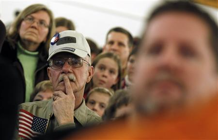Supporters of Republican presidential candidate and former Pennsylvania Senator Rick Santorum listen to his remarks a campaign rally the American Legion in Westerville, Ohio, March 5, 2012.  REUTERS/Jim Young (
