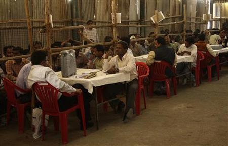 Election officials wait to start the counting of ballots at a counting centre in Allahabad March 6, 2012. REUTERS/Jitendra Prakash