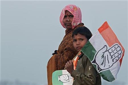 Supporters holding flags of ruling Congress party at Hardoi district in Uttar Pradesh January 28, 2012. REUTERS/Adnan Abidi