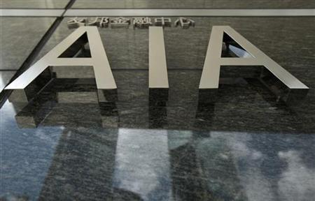 The logo of the AIA tower is seen at its entrance in Hong Kong July 13, 2010.   REUTERS/Tyrone Siu