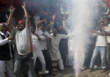 Supporters of Samajwadi Part (SP) celebrate outside their part headquarters in Lucknow March 6, 2012. REUTERS/Pawan Kumar