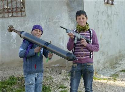 Boys hold up toy guns in the town of Hula near the city of Homs March 5, 2012. Picture taken March 5, 2012. REUTERS/Handout