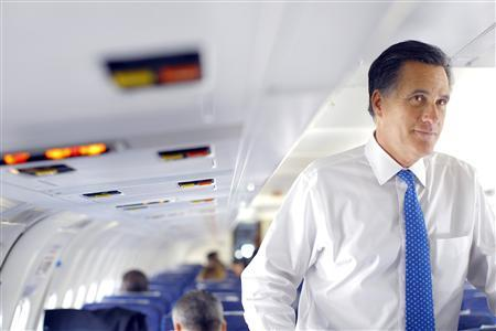 Mitt Romney talks to reporters on his campaign plane before leaving Columbus, Ohio March 6, 2012.   REUTERS/Brian Snyder