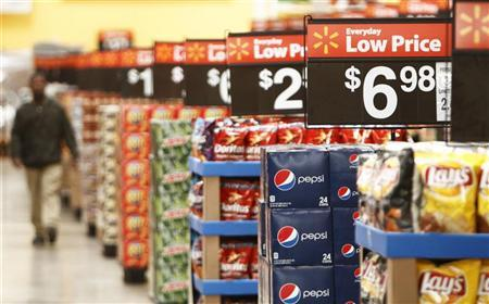 A worker walks through the ''Action Alley'' at a new Wal-Mart store in Chicago, January 24, 2012. REUTERS/John Gress