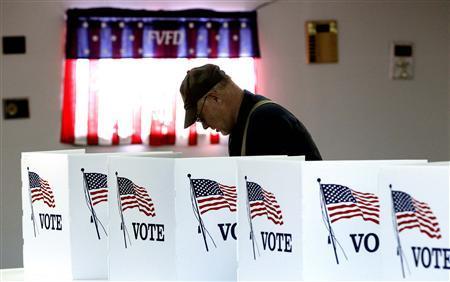 A voter casts a ballot at the Flushing Volunteer Fire Department in Flushing, Ohio, March 6, 2012.  REUTERS/Matt Sullivan