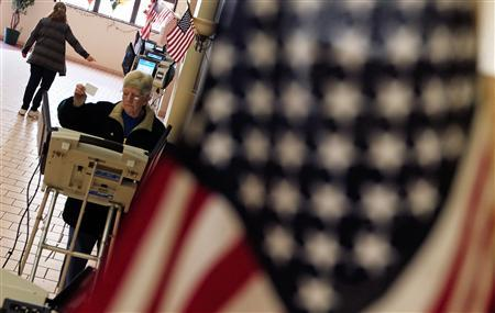 A voter looks over her ballot to place her vote at a polling station in Steubenville, Ohio, March 6, 2012.  REUTERS/Jim Young