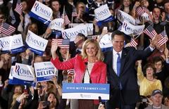"Mitt Romney waves to supporters along with his wife Ann at his ""Super Tuesday"" primary election night rally in Boston, Massachusetts, March 6, 2012. REUTERS/Jessica Rinaldi"