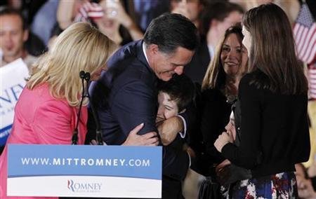 Republican U.S. presidential candidate and former Massachusetts Governor Mitt Romney hugs grandson Thomas as his wife Ann (L), daughter in law Jen (R, rear) and granddaughter Allie look on after he spoke at his ''Super Tuesday'' primary election night rally in Boston, Massachusetts, March 6, 2012. REUTERS/Jessica Rinaldi