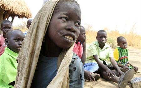 Okello Reagan, 11, who is suffering from nodding syndrome, sits with his peers in Akoya-Lamin Omony village in Gulu district, 384 km (238 miles) north of Uganda's capital of Kampala, February 19, 2012. REUTERS/James Akena