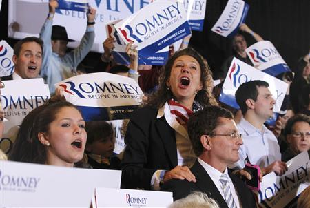 Haley Gerber (L) Pamela Valentine (C) and her husband Bill (lower), supporters of Republican presidential candidate and former Massachusetts Governor Mitt Romney sing at his ''Super Tuesday'' primary election night rally in Boston, Massachusetts, March 6, 2012.   REUTERS/Jessica Rinaldi