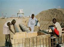 Sudanese oil workers maintain an oil pipeline at a Red Sea export terminal in a file photo. REUTERS/PA/FMS/HB