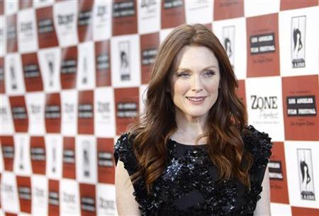 Cast member Julianne Moore poses at the premiere of ''The Kids Are All Right'' during the Los Angeles Film Festival in Los Angeles June 17, 2010. REUTERS/Mario Anzuoni