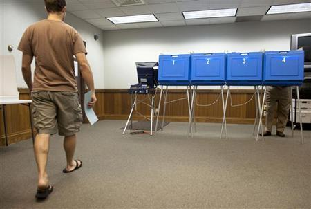 Voters take to the polls in River Hills, Wisconsin August 9, 2011. REUTERS/Darren Hauck