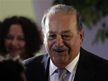 Mexican tycoon Carlos Slim arrives to attend the opening of the Soumaya museum in Mexico City March 1, 2011. REUTERS/Henry Romero/Files