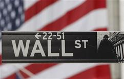 The Wall Street sign is seen in front of the New York Stock Exchange January 22, 2008. REUTERS/Chip East