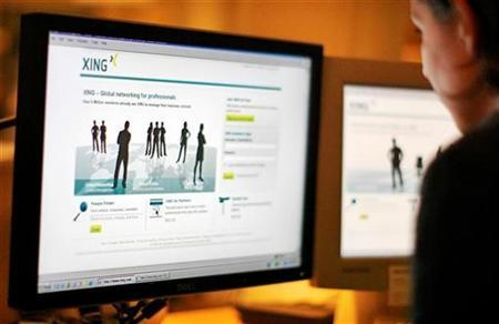 A web-user views the global networking site called Xing in Stockholm, November 20, 2008. REUTERS/Bob Strong/Files