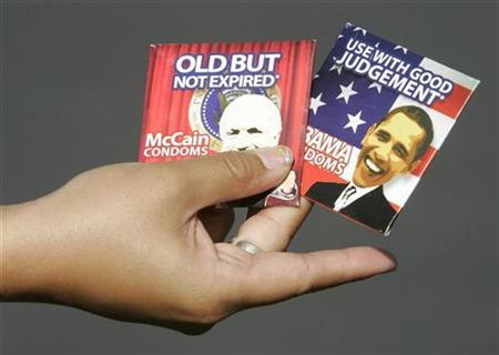 A vendor displays novelty condoms with the likeness of U.S. Republican presidential nominee John McCain (R-Ariz.) and U.S. Democratic presidential nominee Senator Barack Obama (D-IL) during an Obama campaign rally at Bonanza High School in Las Vegas, Nevada October 25, 2008. REUTERS/Steve Marcus (UNITED STATES)