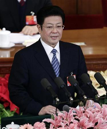 Wang Zhaoguo, vice chairman of the Standing Committee of the National People's Congress (NPC), explains the draft amendment to the Criminal Procedural Law during the second plenary meeting of the NPC at the Great Hall of the People in Beijing March 8, 2012. China's parliament unveiled legislation on Thursday to solidify police powers to secretly hold dissidents and other suspects of state security crimes, a year after a spasm of clandestine detentions drew international condemnation. REUTERS/Jason Lee