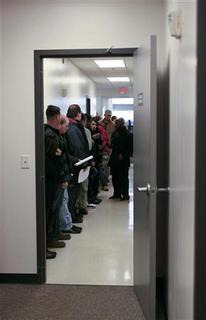 Applicants stand in line before undergoing pre-screening during a job fair in Tennessee Career Center in Murfreesboro, Tennessee, December 10, 2011. REUTERS/M. J. Masotti Jr.