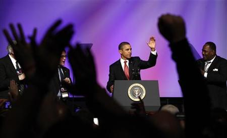 Auto workers applaud as President Barack Obama delivers remarks at the United Auto Workers conference in Washington, February 28, 2012. REUTERS/Kevin Lamarque