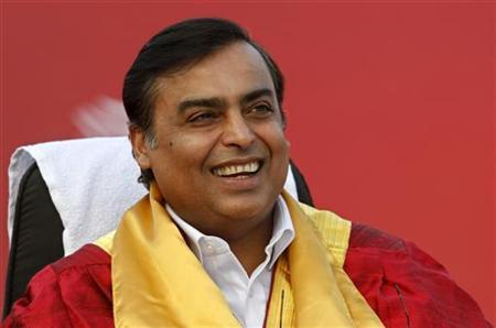 Mukesh Ambani, chairman of Reliance Industries Limited, smiles during a convocation ceremony at Pandit Deendayal Petroleum University (PDPU), a school of petroleum management at Gandhinagar in Gujarat September 27, 2011. REUTERS/Amit Dave/Files