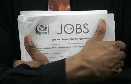 A man carrying a stack of job listings listens to a discussion at the One Stop employment center in San Francisco, California, August 12, 2009. REUTERS/Robert Galbraith/Files