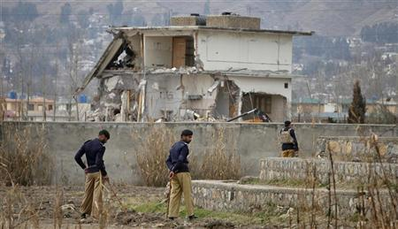 Policemen stand guard near the partially demolished compound where al Qaeda leader Osama bin Laden was killed by U.S. special forces last May, in Abbottabad February 26, 2012. REUTERS/Faisal Mahmood
